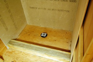 """Drain is in place - top surface about 2"""" above the plywood."""