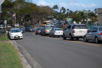 A lineup of Clowns waiting to drive their kids a few blocks home from school, on a beautiful Hawaiian afternoon this January.