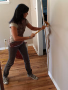 Mrs. MM destroys a portion of our new house in a recent work session.