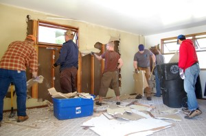 Early in this project, this group of volunteer Mustachians stopped by to help destroy this room, among other things. (At least I was able to pay them with beers and dinner at my place)