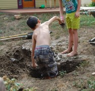 Little MM and a friend from the neighborhood engage in healthy dirtplay.