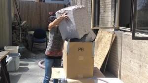 Mrs. MM loads a 20-pound chunk into a homemade cardboard hopper (long story)