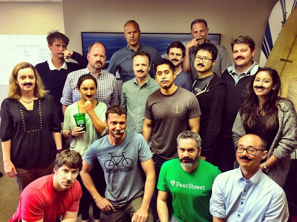 A portion of the PeerStreet team poses on our meeting day. With added Mustaches.