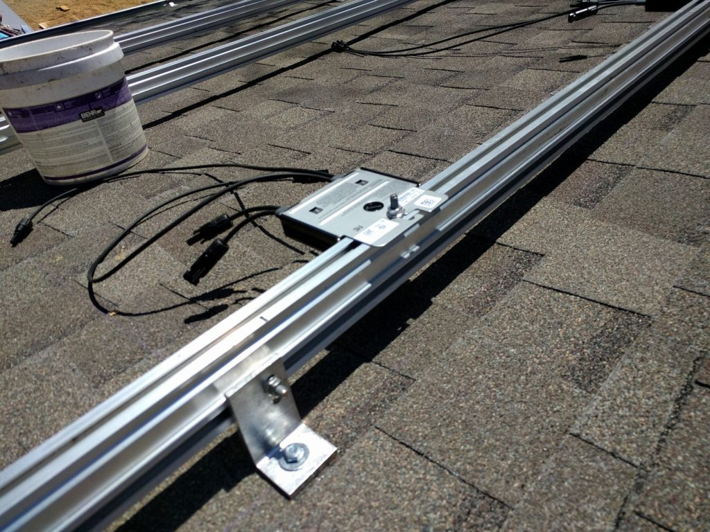 My Diy Solar Power Setup Free Energy For Life Mr Money Mustache Metal Conduit Is Tough Stuff But Its Heavy Hard To Work With And Optimizer Mounting Face Down Plus A Good Shot Of The Connections Between Roof Brackets Rails Note Installer Saw This Said He